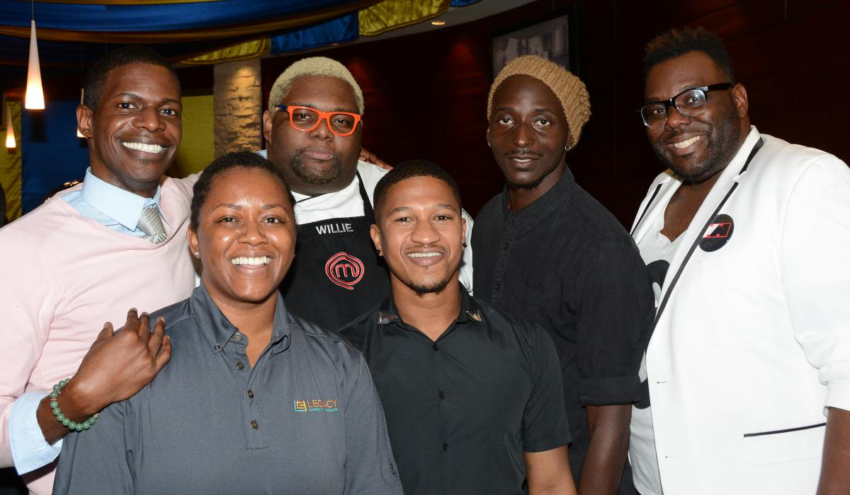 A group of Black men smile for the camera