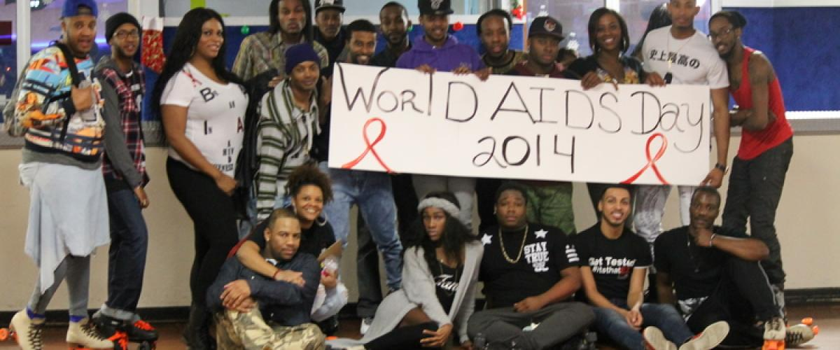 Group of young Black women and men holding a World AIDS Day sign