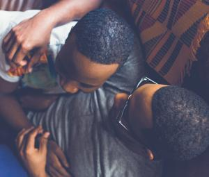 Two Black men hugging