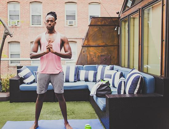 Young Black man in a yoga pose